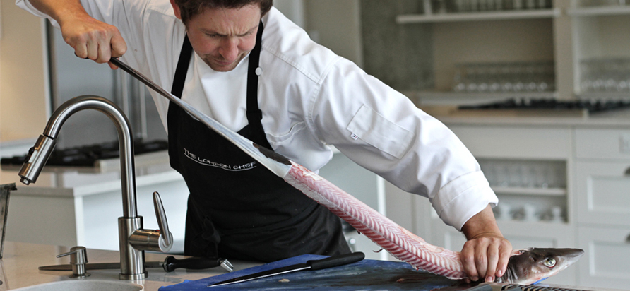 It takes strength to skin a dogfish. Chef Dan Hayes shows how it's done. Photo by P. Bagi