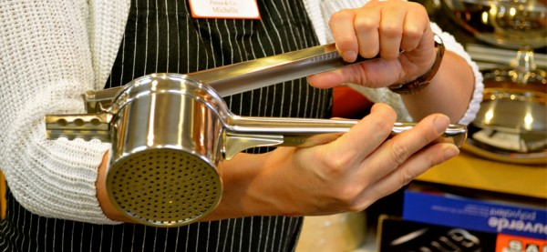 Michelle Kattler of Penna & C demonstrating how to use the Browne Cuisipro Stainless Steel Potato Ricer, which is their best seller of this type of gadget.