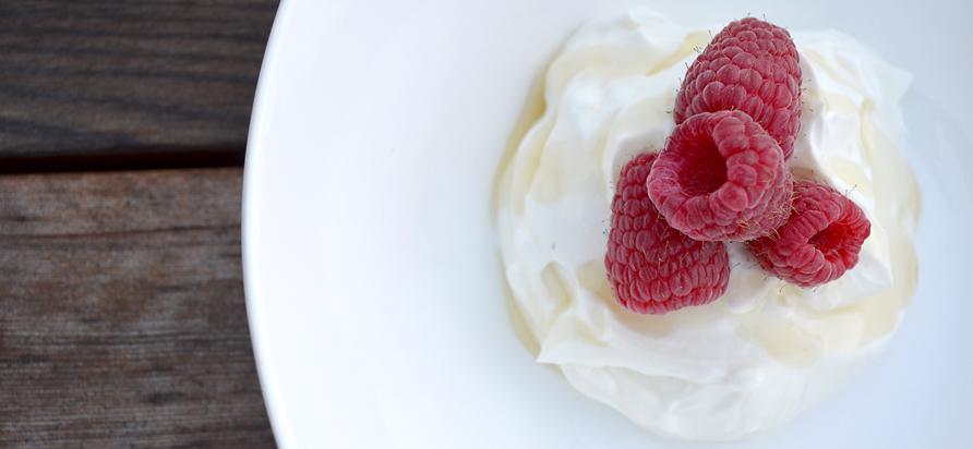 Liberte's 0% plain Greek yogurt, served with a drizzle of honey and fresh raspberries Photo by Ellie Shortt