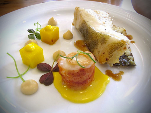 Roasted bone in turbot with butter poached lobster saffron potatoes, lobster hollandiase, cauliflower puree, lobster vinaigrette