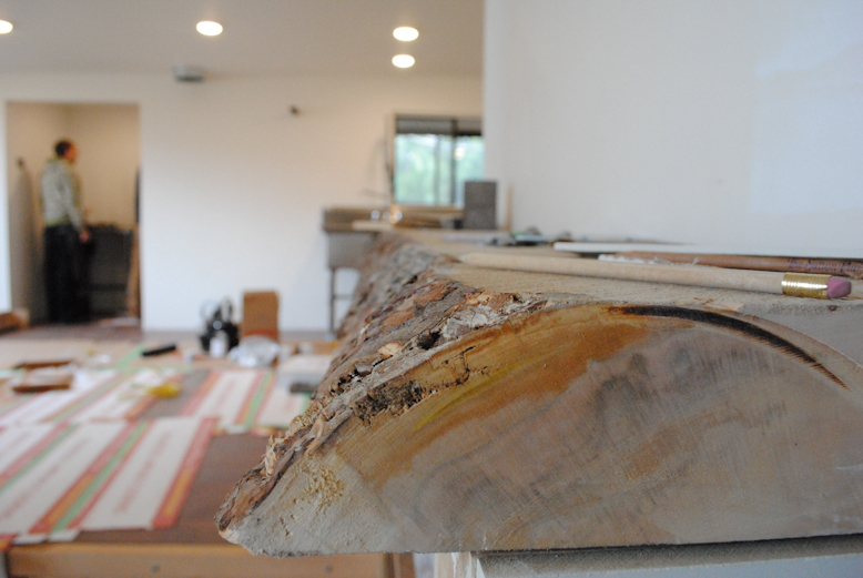 Raw wood edging for the shelf adds a natural touch