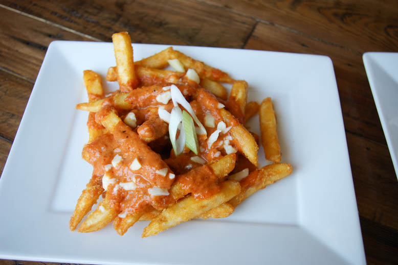 Varsha's Poutine with butter chicken sauce