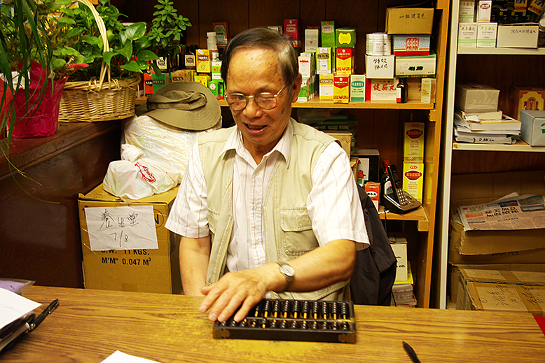 Dr. Wong with the abacus.778