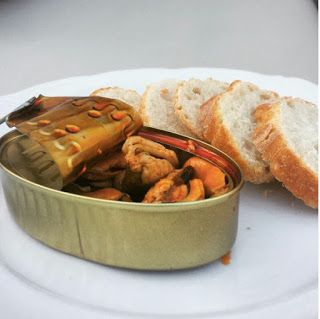 "Instagram @fancy_frites ""Sometimes it's the simple things in life. I had canned mussels at Perro Negro and fell in love. Good quality canned mussels almost have a goat cheese type taste to it but in the best way possible. Paired with crusty bread it makes for a great snack! I bought these here in Spain today ~$4"""