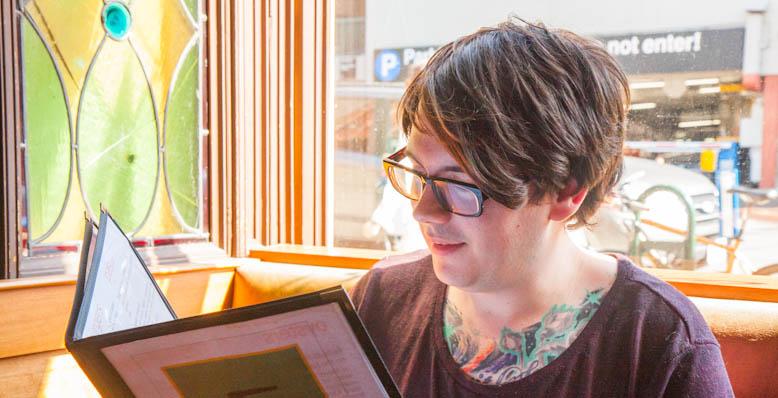 Jon reads menu