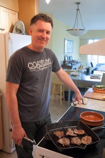Sean smiling at stove