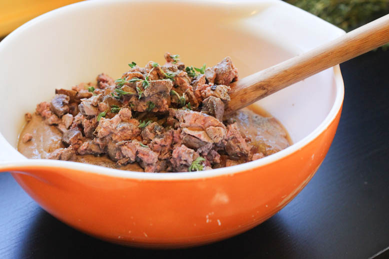 mixing together the blended liver with chopped liver, herbs and pancetta
