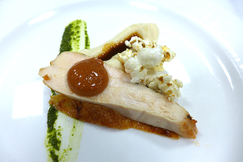 Vista 18: Seared chicken breast with celeriac, charred tomato, cilantro chimichurri and chicken skin popcorn