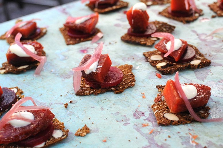 Candied salmon, house made seed cracker, beet and onion from Stage