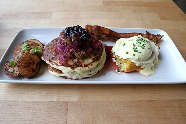 Eggs Benedict on homemade cornbread, pancakes with carne asada and fruit compote